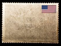 Vintage blank posted stamp with USA flag isolated on black background. Old paper texture stock image