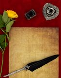 Vintage blank preachment, yellow rose, ornate silver quill stand, ink pot and ornamented quill - Love letter concept royalty free stock images