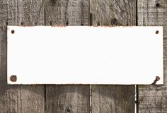 Vintage blank rustic white metal sign On Wooden Background Stock Image