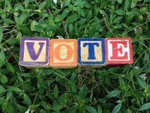 Vote. Vintage Blocks Spell out vote stock photos