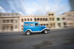 Vintage Blue American Taxi Car Havana Cuba. Vintage blue American car taxi driving in front of classic colonial architecture on the Malecon in Central Havana Stock Images