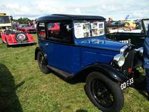Vintage blue Austin Seven car. Vintage Austin Seven car displayed outdoor at Northumberland Wings & Wheels festival at Eshott Airfield north of Morpeth, England stock photos