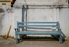A vintage blue bench with old wall at sunny day. In Mandalay, Myanmar Royalty Free Stock Photography