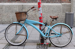 Vintage blue bicycle parks on the road in munich city. Lock with the electric collar royalty free stock photography