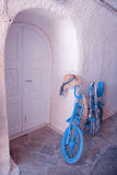 Vintage blue bike with white door, Greece Stock Photos
