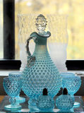 Vintage blue bubble glass decanter with glasses Royalty Free Stock Image