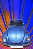 Vintage Blue Car 60's. Transport, Vintage Blue Car 60's, on Background Red and Blue Strips Royalty Free Stock Photography