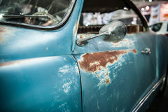 Vintage blue car with rust Stock Photo