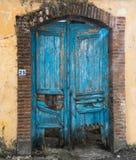Vintage blue closed damaged door Stock Photo