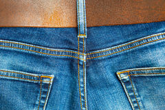 Vintage blue denim with seams and leather belt Stock Images