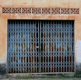 Vintage blue doors in a grungy wall, French colonial style, Laos Royalty Free Stock Image