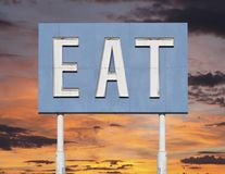 Vintage Blue Eat Sign with Sunset Royalty Free Stock Photo