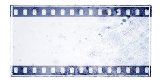Vintage blue film strip frame with mossy wall surface Stock Photos