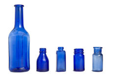 Vintage blue glass bottles. A group of vintage blue glass bottles isolated on white stock images