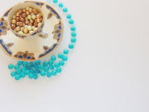 Vintage blue and gold tea cup with golden pearls and fantasy crystals Stock Photography