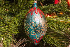 Vintage blue and golden ball decoration on christmas tree Royalty Free Stock Photos