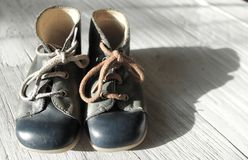 Vintage blue grey baby shoes stock photo