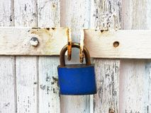 Vintage blue lock on white board. Vintage blue lock on white old wooden board Stock Photos
