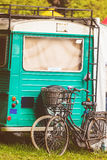 Vintage blue motorhome with bicycles in front stock image
