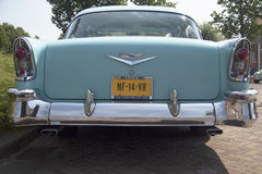 Vintage blue oldtimer car. Back view of a Chevrolet bel air 1956 at the annual oldtimer show in Medemblik Stock Photos