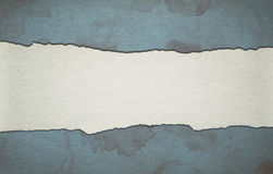 Vintage blue paper background with stripe and dirty stains Stock Photos