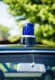 Vintage blue police light on patrol vehicle roof.. Vintage blue police light on the roof of a police patrol vehicle stock photo