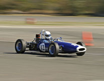 Vintage blue race car. Antique blue race car during a road race royalty free stock image