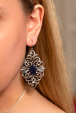 Vintage blue stone ear ring. Vintage earring with blue gemstone hanging at an ear of a blond girl royalty free stock photo