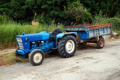 Vintage Blue Tractor and Trailer Royalty Free Stock Photos