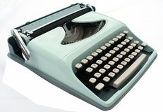 Vintage blue typewriter isolated on white. A light brigt typewriter isolated on white royalty free stock photos