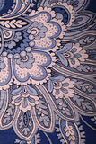 Vintage blue wallpaper with paisley pattern. Detail of vintage blue wallpaper with paisley pattern closeup, vertical image Royalty Free Stock Photography
