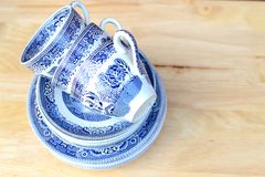vintage blue willow pattern china cups and saucers Royalty Free Stock Images