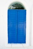 Vintage blue window is closed with wood on white wall Stock Photography