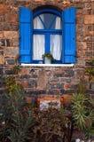 Vintage blue window, Greece. Stock Photos