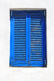 Vintage blue window with shutter (Greece) Royalty Free Stock Photos