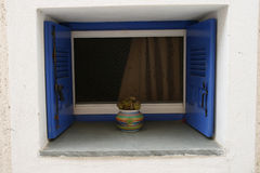 Vintage blue window on the white wall. Greece Stock Image