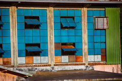 Vintage blue windows in old mill Stock Photo