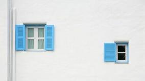 Vintage blue windows on the wall Stock Photos