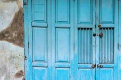 Vintage blue wood folding door royalty free stock photos