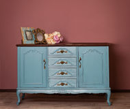Vintage blue wooden dresser, tender bouquet and two frames. Royalty Free Stock Photos