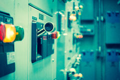 Vintage and blur tone of Electrical switchgear room,Industrial e. Lectrical switch panel on plant and process control with grainy style royalty free stock images