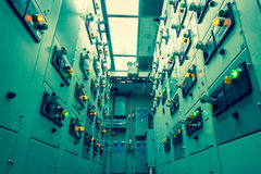 Vintage and blur tone of Electrical switchgear room,Industrial e. Lectrical switch panel on plant  and process control with grainy style Stock Photos