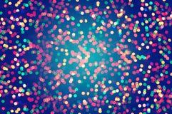 Vintage Blurred lights abstract color. Blurred Colorful celebration lights on black background Stock Images