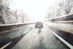 Vintage blurry heavy snowfall car driving Royalty Free Stock Photos