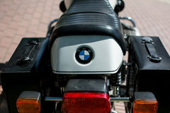 Vintage BMW motorcycle on annual oldtimer car show. A DSLR photo of BMW motorcycle.Photographed from behind with leather saddlebags. The motorcycle is displayed royalty free stock photography