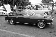 Vintage bmw sports car. Vintage german sports car lateral view. 1967 bmw 1600 gt designed by frua. at outdoors event among other classic cars. taken in black and Stock Photography