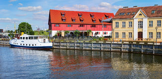 Vintage boat docked at Dane rivers quay. Old Town district. Klaipeda, Lithuania. Stock Photos