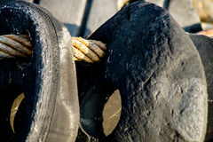 Vintage Boat Fenders. Vintage Black Boat Fenders lying on the deck, Close up Royalty Free Stock Image