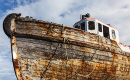 Vintage boat resting in dry dock. Old boat hull in dry dock Royalty Free Stock Images