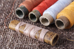 Vintage bobbins with colorful threads Stock Images
